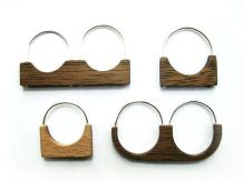 Wood rings with silver band and detailing essay